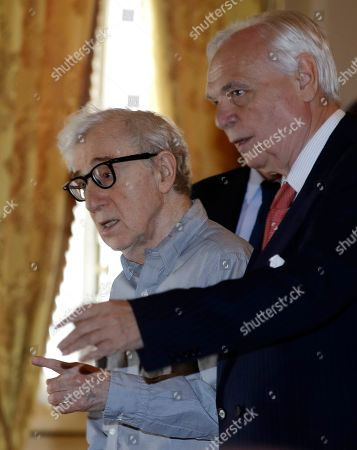 Director Woody Allen attends a press conference flanked by La Scala theater manager Alexander Pereira, at La Scala opera house, in Milan, Italy,. Woody Allen is directing Puccini's ' Gianni Schicchi ' opera, which opens Saturday in Milan. The opera premiered in Los Angeles and it is making its debut at La Scala