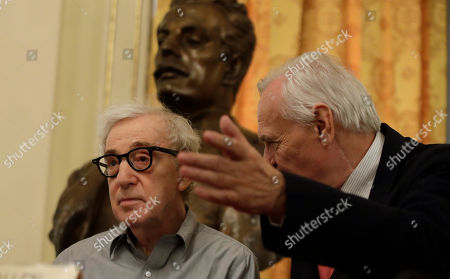 Director Woody Allen attends a press conference flanked by La Scala theater manager Alexander Pereira, at La Scala opera house, in Milan, Italy,. Woody Allen is directing Puccini's ' Gianni Schicchi ' opera, which opens Saturday in Milan. The opera premiered in Los Angeles and it's making its debut at La Scala