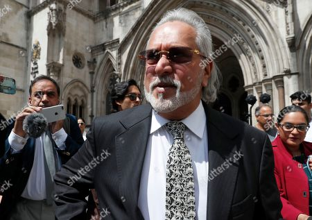 Indian business man Vijay Mallya leaves the High Court for a lunch break as he appeals against extradition to India to face fraud charges at the Royal Courts of Justice in London, . Mallya, whose business empire once included Kingfisher beer, left India two and a half years ago after defaulting on debts of more than a billion dollars linked to a failing venture, Kingfisher Airlines