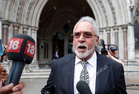 Indian business man Vijay Mallya leaves the high Court after winning the legal right to appeal against extradition to India to face fraud charges, at the Royal Courts of Justice in London, . Mallya, whose business empire once included Kingfisher beer, left India two and a half years ago after defaulting on debts of more than a billion dollars linked to a failing venture, Kingfisher Airlines