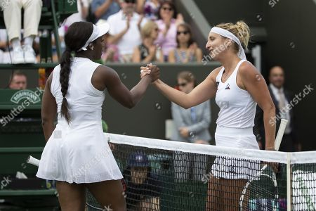 Timea Bacsinszky of Switzerland (R) and Sloane Stephens of the USA shake hands after their first round match during the Wimbledon Championships at the All England Lawn Tennis Club, in London, Britain, 02 July 2019.