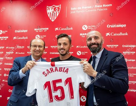 Sevilla FC's President Jose Castro (L) and Sports Director Ramon Rodriguez aka Monchi pose with Spanish midfielder Pablo Sarabia (C) during a press conference in which Sarabias' signing with Paris Saint-Germain was announced, in Seville, Spain, 02 July 2019. PSG has confirmed on social media the signing of Sarabia for the next five seasons.