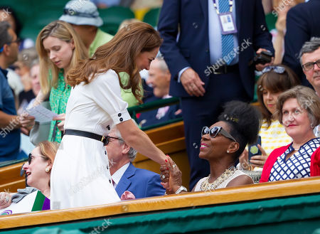 Catherine, Catherine Duchess of Cambridge is greeted by Floella Benjamin OBE, as she takes her teat on Centre Court at Wimbledon