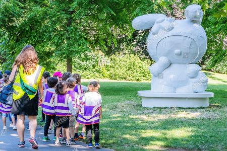 School children pause to look at a work - Tom Sachs, My Melody (2008), Presented by Galerie Thaddaeus Ropac - Frieze Sculpture, one of the largest outdoor exhibitions in London, including work by 25 international artists from across five continents in Regents Park from 3rd July - 6th October 2019.