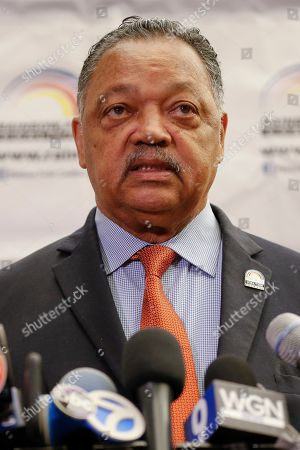 Rev. Jesse Jackson addresses reporters at the start of the Rainbow PUSH Coalition Annual International Convention in Chicago