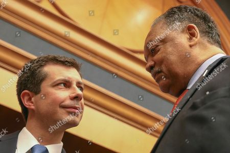 Democratic presidential candidate and South Bend, Ind., Mayor Pete Buttigieg, left, speaks with Rev. Jesse Jackson, right, ahead of a news conference at the Rainbow PUSH Coalition Annual International Convention in Chicago