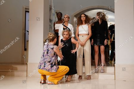 German actress Christine Urspruch (C) and models wearing creations by German desiger Anja Gockel wait backstage during rehearsals at the Mercedes-Benz Fashion Week in Berlin, Germany, 02 July 2019. The Spring/Summer 2020 collections are presented at the MBFW Berlin from 01 to 03 July.