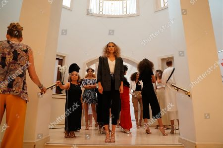 German actress Christine Urspruch (2-L) and models wearing creations by German desiger Anja Gockel wait backstage during rehearsals at the Mercedes-Benz Fashion Week in Berlin, Germany, 02 July 2019. The Spring/Summer 2020 collections are presented at the MBFW Berlin from 01 to 03 July.