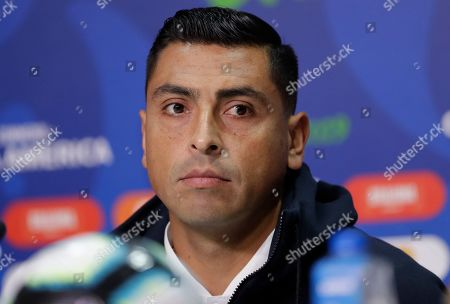 Chile's Gonzalo Jara looks on during a press conference in Porto Alegre, Brazil, . Chile will face Peru on July 3 in the semifinals for the Copa America