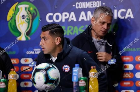 Stock Image of Chile's Gonzalo Jara, left, and coach Reinaldo Rueda attend a press conference in Porto Alegre, Brazil, . Chile will face Peru on July 3 in the semifinals for the Copa America