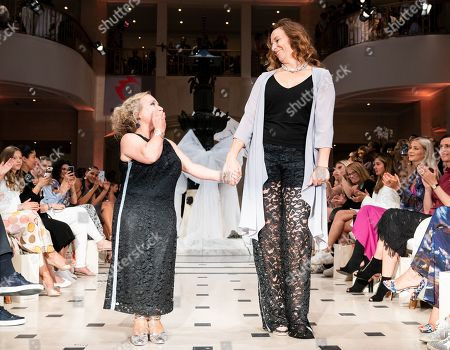 German designer Anja Gockel (R) poses with German actress Christine Urspruch (L) on the catwalk at her show during the Mercedes-Benz Fashion Week in Berlin, Germany, 02 July 2019. The Spring/Summer 2020 collections are presented at the MBFW Berlin from 01 to 03 July.