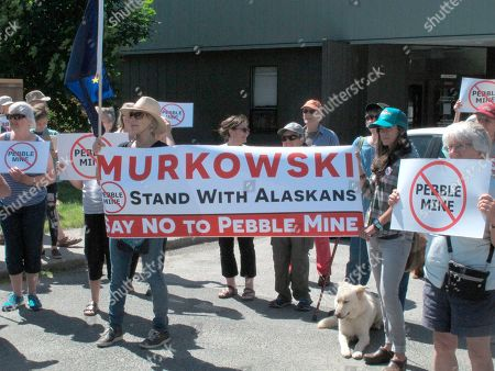 Stock Picture of In this June 25, 2019, photo, people gather outside U.S. Sen. Lisa Murkowski's office in Juneau, Alaska, to protest the proposed Pebble Mine. During a comment period that ended, a U.S. Environmental Protection Agency official cited concerns with a draft environmental review the U.S. Army Corps of Engineers has done on the project