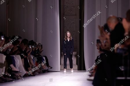 Designer Clare Waight Keller accepts applause at the end of the Givenchy Haute Couture Fall-Winter 2020 fashion collection presented in Paris
