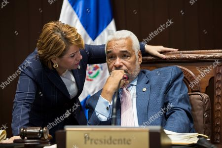 Dominican President of the Deputy Chamber Radhames Camacho (R) talks with the deputy Lucia Medina (L), sister of President Danilo Medina, during a session in Santo Domingo, Dominican Republic, 02 July 2019. The National Congress has a tense atmosphere due the possible constitutional reform that would allow President Danilo Medina participate for his third consecutive period.