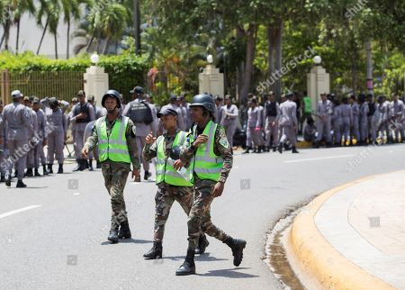 Military and Police guard the area next to the National Congress during a session in Santo Domingo, Dominican Republic, 02 July 2019. The National Congress has a tense atmosphere due the possible constitutional reform that would allow President Danilo Medina participate for his third consecutive period.