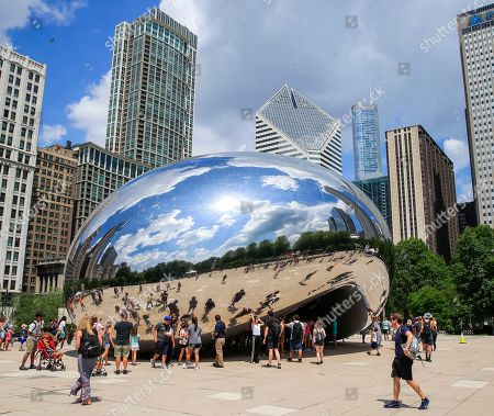 People gather at the Cloud Gate sculpture in Chicago, Illinois, USA, 02 July 2019. According to reports the sculpture, created by Indian-born British artist Sir Anish Kapoor and affectionately know as The Bean, was vandalized with spray paint late 01 July. Seven people have been arrested for defacing the public attraction. City workers removed the paint.