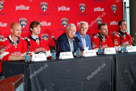 Florida Panthers President of Hockey Operations & General Manager Dale Tallon, third from left, along with head coach Joel Quenneville, third from right, introduce new players Anton Stralman, left, Sergei Bobrovsky, second from left, Brett Connolly, second from right, and Noel Acciari during a news conference, in Sunrise, Fla