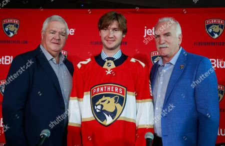 Florida Panthers President of Hockey Operations & General Manager Dale Tallon, left, and Head Coach Joel Quenneville, right, pose with new goalkeeper Sergei Bobrovsky after a news conference, in Sunrise, Fla. The Panthers, New York Rangers and Nashville Predators were winners on Day 1 of NHL free agency, signing the best players available to seven-year, lucrative contracts
