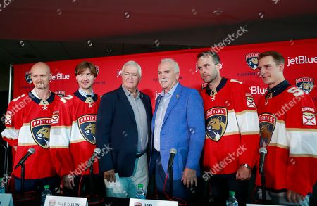Florida Panthers President of Hockey Operations & General Manager Dale Tallon, third from left, and Head Coach Joel Quenneville, third from right, pose with new players Anton Stralman, left, Sergei Bobrovsky, second from left, Brett Connolly, second from right, and Noel Acciari, right, after a news conference, in Sunrise, Fla
