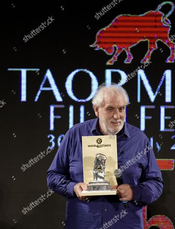 Stock Image of Phillip Noyce receives the 'Taormina Art Award' during a ceremony at the Teatro Antico as part of the 65th annual Taormina Film Festival, in Taormina, Sicily Island, Italy, 02 July 2019. The festival runs from 30 June to 06 July.