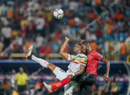 Masunguna Alex Afonso of Angola and Kalifa Coulibaly of Mali challenging for the ball during the African Cup of Nations match between Angola and Mali at the Ismailia Stadium in Ismailia, Egypt