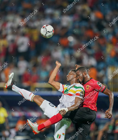 Stock Image of Masunguna Alex Afonso of Angola and Kalifa Coulibaly of Mali challenging for the ball during the African Cup of Nations match between Angola and Mali at the Ismailia Stadium in Ismailia, Egypt