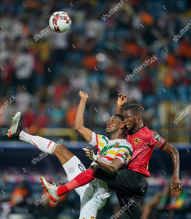 Stock Photo of Masunguna Alex Afonso of Angola and Kalifa Coulibaly of Mali challenging for the ball during the African Cup of Nations match between Angola and Mali at the Ismailia Stadium in Ismailia, Egypt