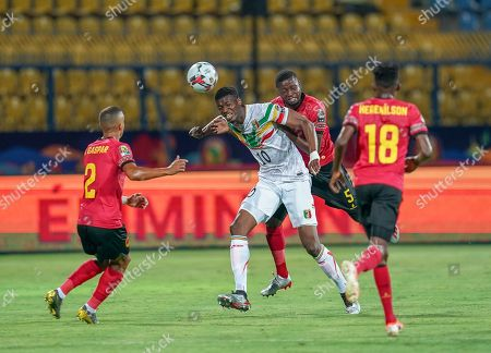 Kalifa Coulibaly of Mali and Masunguna Alex Afonso of Angola challenging for the ball during the African Cup of Nations match between Angola and Mali at the Ismailia Stadium in Ismailia, Egypt