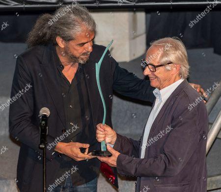 Bristish filmaker Ken Loach (R) receives the 'Masters of Cinema' award from Spanish filmmaker Fernando Leon de Aranoa (L) during the inauguration of the IX Atlantida Film Festival at the Bellver Castle in Palma de Mallorca, Balearic Islands, Spain, 02 July 2019.