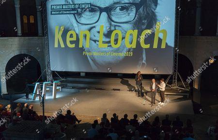 Bristish filmaker Ken Loach (C) delivers a speech after receiving the 'Masters of Cinema' award from Spanish filmmaker Fernando Leon de Aranoa (L) during the inauguration of the IX Atlantida Film Festival at the Bellver Castle in Palma de Mallorca, Balearic Islands, Spain, 02 July 2019.
