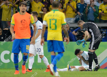 Argentina's goalkeeper Franco Armani, right, comforts teammate Argentina's Leandro Paredes after being defeated 2-0 by Brazil in a Copa America semifinal soccer match at Mineirao stadium in Belo Horizonte, Brazil