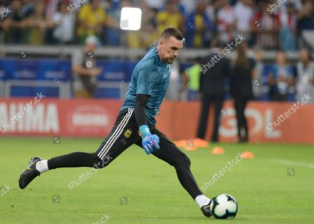 Argentina's goalkeeper Franco Armani warms up prior a Copa America semifinal soccer match at Mineirao stadium in Belo Horizonte, Brazil