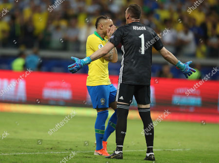 Brazil's Everton, left, and Argentina's goalkeeper Franco Armani react during a Copa America semifinal soccer match at the Mineirao stadium in Belo Horizonte, Brazil