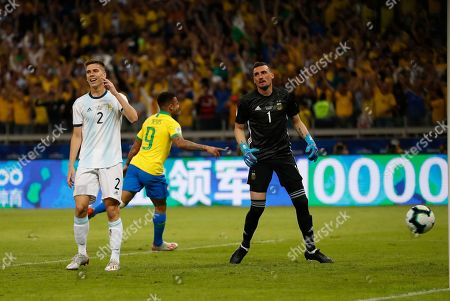 Argentina's goalkeeper Franco Armani, right and Argentina's Juan Foyth react after Brazil's Gabriel Jesus scored his side's opening goal during a Copa America semifinal soccer match at the Mineirao stadium in Belo Horizonte, Brazil