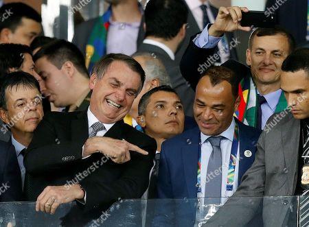 Brazil's President Jair Bolsonaro (L) jokes with Brazil's former soccer player Cafu (R) during the Copa America 2019 semi-finals soccer match between Brazil and Argentina at Mineirao Stadium in Belo Horizonte, Brazil, 02 July 2019.