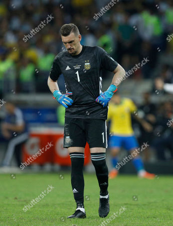 Argentina's goalkeeper Franco Armani reacts after Brazil's Roberto Firmino scored a goal during a Copa America semifinal soccer match at Mineirao stadium in Belo Horizonte, Brazil