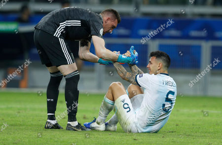 Argentina's goalkeeper Franco Armani, left, conforts Leandro Paredes at the end of Copa America semifinal soccer match against Brazil at the Mineirao stadium in Belo Horizonte, Brazil, . Brazil won 2-0 and and advanced to the final