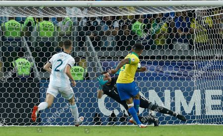 Brazil's Gabriel Jesus, right, scores his first's side goal against Argentina's goalkeeper Franco Armani during a Copa America semifinal soccer match at Mineirao stadium in Belo Horizonte, Brazil