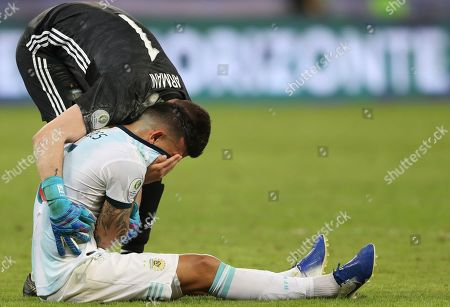 Argentina's Leandro Paredes is comforted by goalkeeper Franco Armani at the end of a Copa America semifinal soccer match against Brazil at the Mineirao stadium in Belo Horizonte, Brazil, . Brazil won 2-0 and and advanced to the final