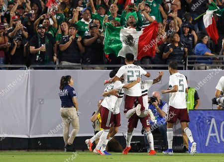 Mexico defender Uriel Antuna, left, midfielder Jesus Gallardo (23), midfielder Jonathan Dos Santos (6), and defender Diego Reyes (5) celebrate a goal against Haiti by forward Raul Jimenez, second from left, during overtime of a CONCACAF Gold Cup soccer match, in Glendale, Ariz