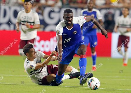 Mexico defender Hector Moreno drags down Haiti forward Frantzdy Pierrot (20) during the second half of a CONCACAF Gold Cup soccer match, in Glendale, Ariz