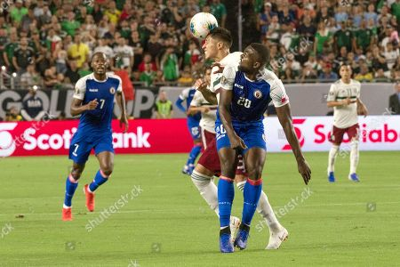 Mexico's Carlos Salcedo (C) and Haiti's Frantzdy Pierrot (C-R) battle for a ball during the semi-final Concacaf Gold Cup match between Haiti and Mexico at State Farm Stadium in Glendale, Arizona, USA, 02 July 2019. Mexico won the match during the overtime.
