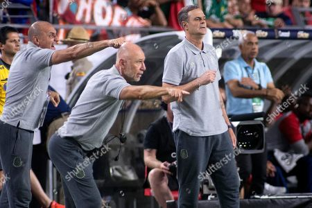 Mexican coaches (L-R) Gustavo Pinero, Sergio Giovagnoli and Jorge Theiler shout instructions to their players during the semi-final Concacaf Gold Cup match between Haiti and Mexico at State Farm Stadium in Glendale, Arizona, USA, 02 July 2019. Mexico won the match during the overtime. The head coach Gerardo Martino was serving a suspension leaving sideline duties to his assistants.