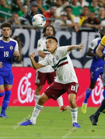 Mexico midfielder Carlos Rodriguez (8) during the first half of a CONCACAF Gold Cup soccer match against Haiti, in Glendale, Ariz
