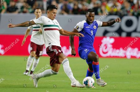 Mexico defender Carlos Salcedo (3) and Haiti forward Duckens Nazon (9) during the first half of a CONCACAF Gold Cup soccer match, in Glendale, Ariz