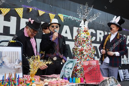 Demonstrators set up a mock birthday cake during a 48th birthday 'party' for Wikileaks founder Julian Assange at Federation Square in Melbourne, Victoria, Australia, 03 July 2019. Julian Assange, who was arrested in March 2019 at the Ecuadorean embassy in London, Britain, is serving a 50-week prison sentence for breaching his bail in 2012 by entering the embassy in a bid to avoid being extradited to Sweden to face allegations of rape and sexual assault.