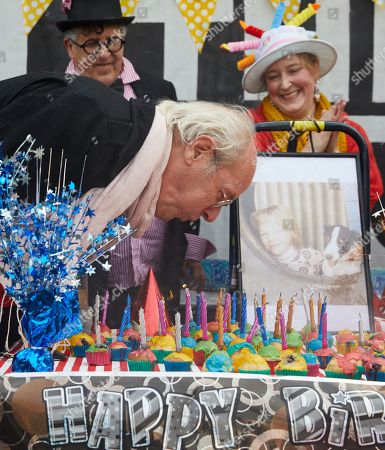 John Shipton, the father of Wikileaks founder Julian Assange, blows out candles during a 48th birthday 'party' for Julian Assange at Federation Square in Melbourne, Victoria, Australia, 03 July 2019. Julian Assange, who was arrested in March 2019 at the Ecuadorean embassy in London, Britain, is serving a 50-week prison sentence for breaching his bail in 2012 by entering the embassy in a bid to avoid being extradited to Sweden to face allegations of rape and sexual assault.