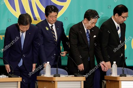 (L-R) Natsuo Yamaguchi, chief representative of the New Komeito Party, Shinzo Abe, Japan's prime minister and president of the Liberal Democratic Party (LDP), Yukio Edano, head of the Constitutional Democratic Party of Japan, and Kazuo Shii, chairman of the Japanese Communist Party, react after posing during a photo session prior to their debate ahead of the upper house election at the Japan National Press Club in Tokyo, Japan, 03 July 2019.