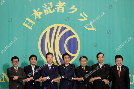 Stock Picture of (L-R) Ichiro Matsui, mayor of Osaka and leader of the Nippon Ishin (Japan Innovation Party), Yuichiro Tamaki, leader of the Democratic Party for the People, Natsuo Yamaguchi, chief representative of the New Komeito Party, Shinzo Abe, Japan's prime minister and president of the Liberal Democratic Party (LDP), Yukio Edano, head of the Constitutional Democratic Party of Japan, Kazuo Shii, chairman of the Japanese Communist Party, and Hajime Yoshikawa, secretary general of the Social Democratic Party, link their hands during a photo session prior to their debate ahead of the upper house election at the Japan National Press Club in Tokyo, Japan, 03 July 2019.