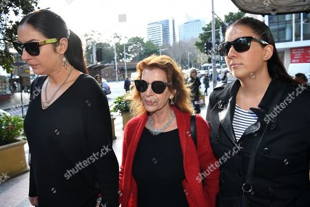 Rosa Miano (C), wife of Australian actor John Jarratt, arrives at the Downing Centre Local Court in Sydney, New South Wales, Australia, 03 July 2019. Jarratt has pleaded not guilty to allegations of raping a former housemate in 1976, saying that they had consensual sex, media reported.